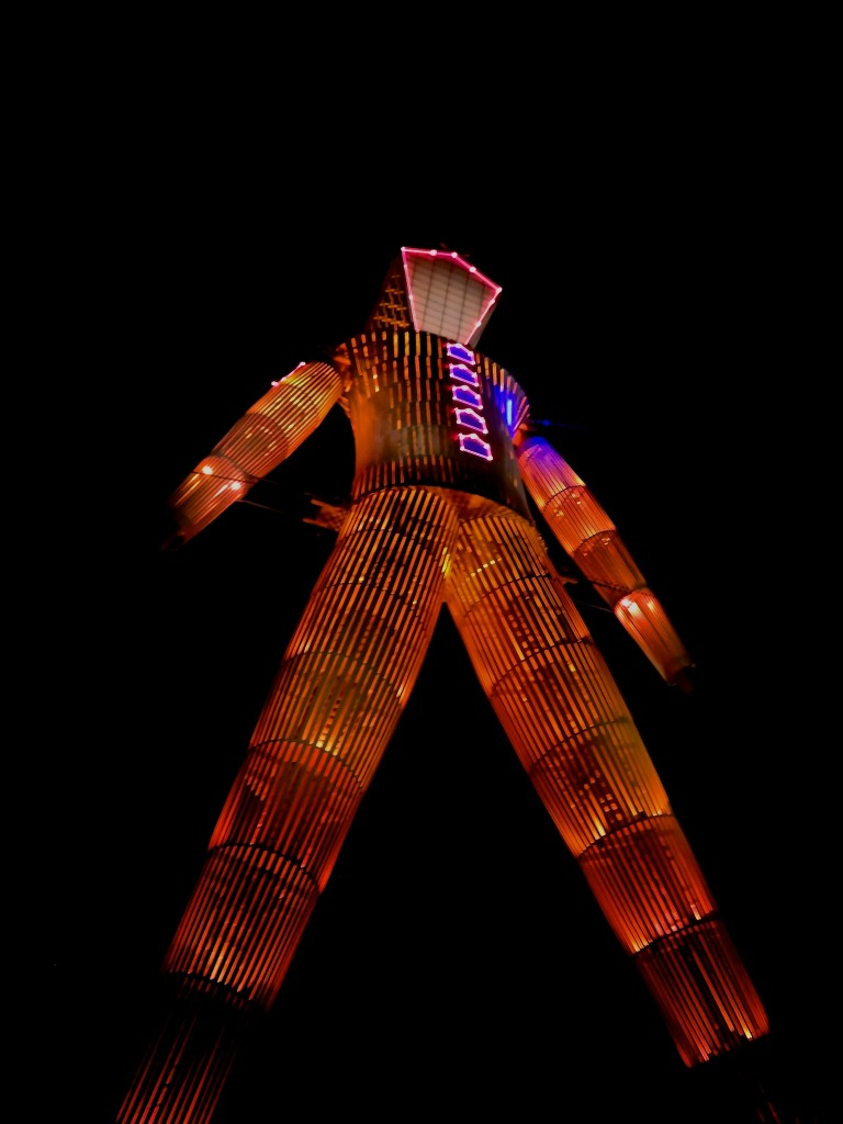 Burning man at night